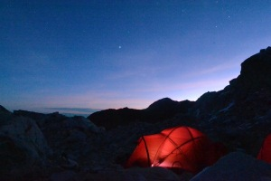 4 man tents at high camp after dark