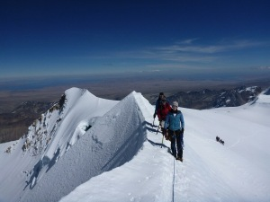 Percy's rope team approaching the Chachakomani Summit