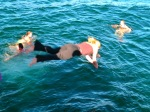 A few hardy souls dive into Lake Titicaca